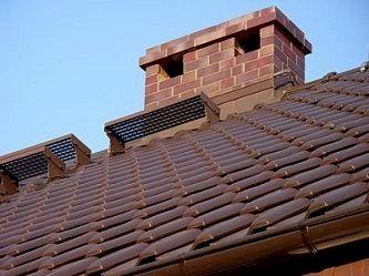 дымоход на крыше дома